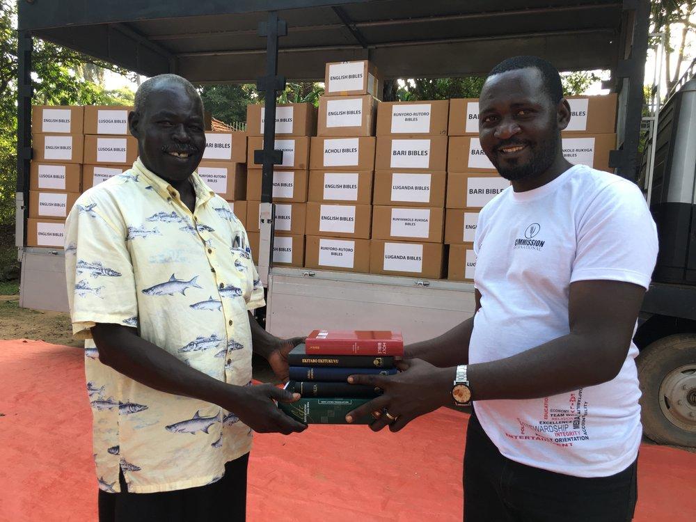 Pastor Bonny Okot receives his study Bibles
