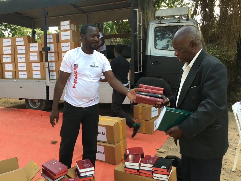 Pastor Joseph Byeitaka receives his study Bibles