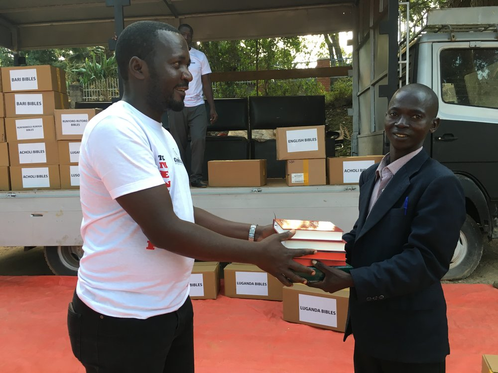Pastor Emmanuel Modi receives his study Bibles