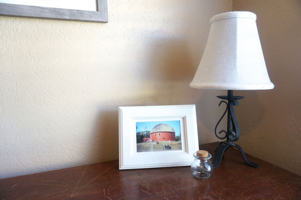 Here sits my lamp for nightfall, collection of nibs and a framed photo I bought by Robyn Icks Photography.