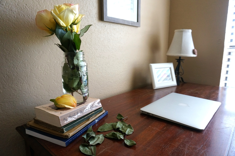 Because who wouldn't want fresh roses on their desk for inspiration?