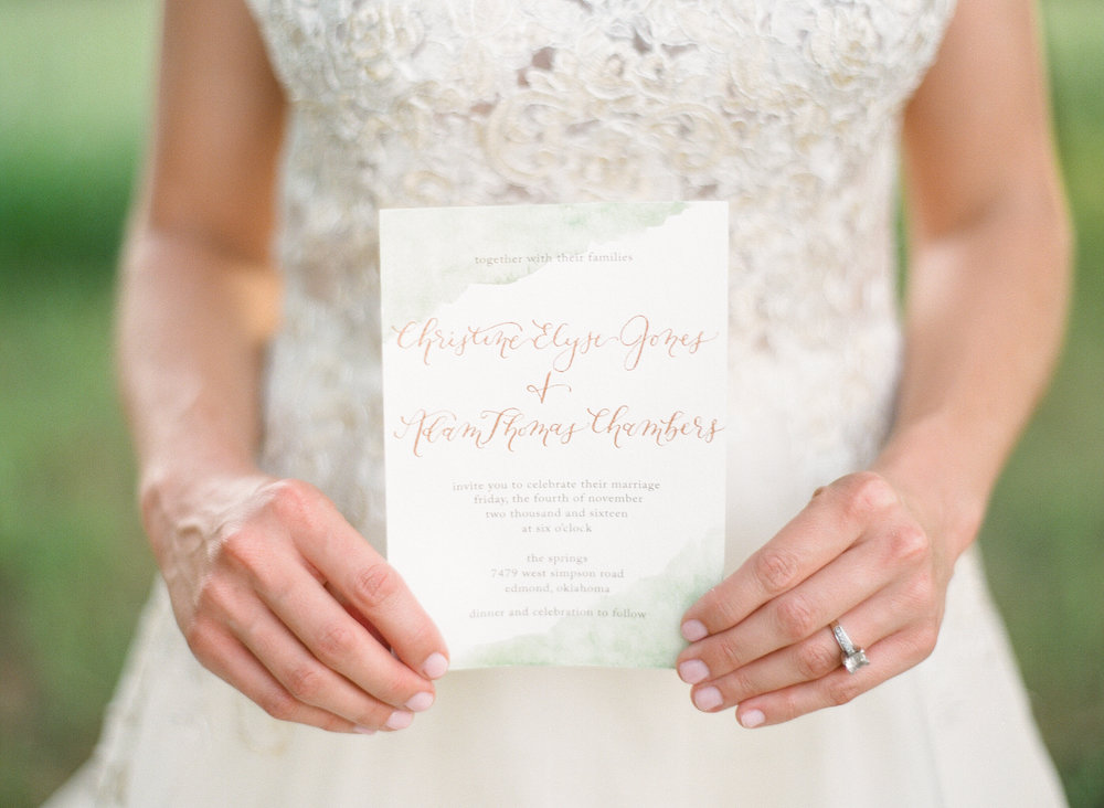 Green watercolor and gold calligraphy wedding invitation