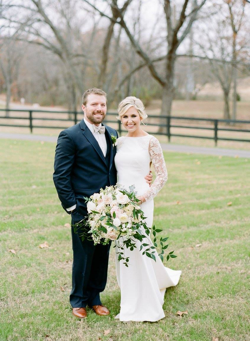 Josh and Teale Janysek on their wedding day at Spain Ranch in Jenks, Oklahoma. Photo by  Amanda Watson Photography.