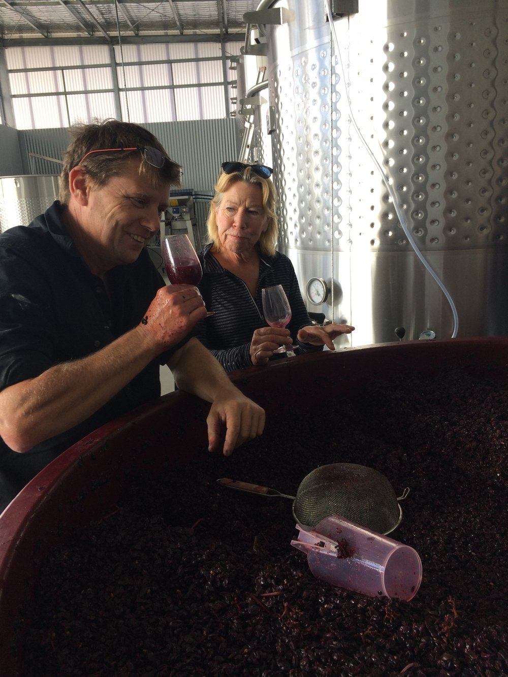The viticulturist and the winemaker. Sheena and Julian taste the Native Point pinot noir ferment.