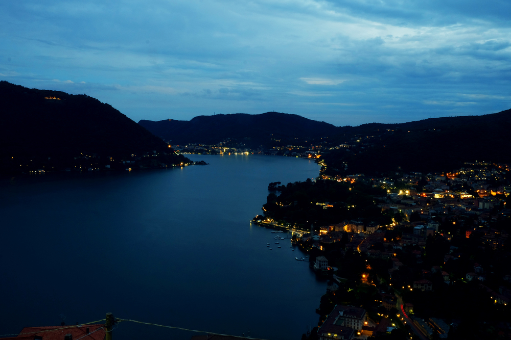 Lake Como at dusk.  Thankfully it petered out by nightfall, the first clear skies they had seen in nearly a month.