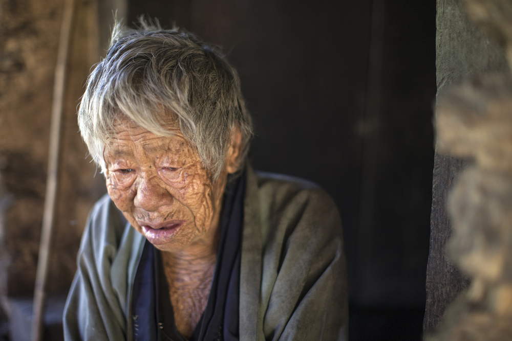 A 110 year old Bhutanese woman laments the loss of her sight and hearing. Bhutan. 2009.