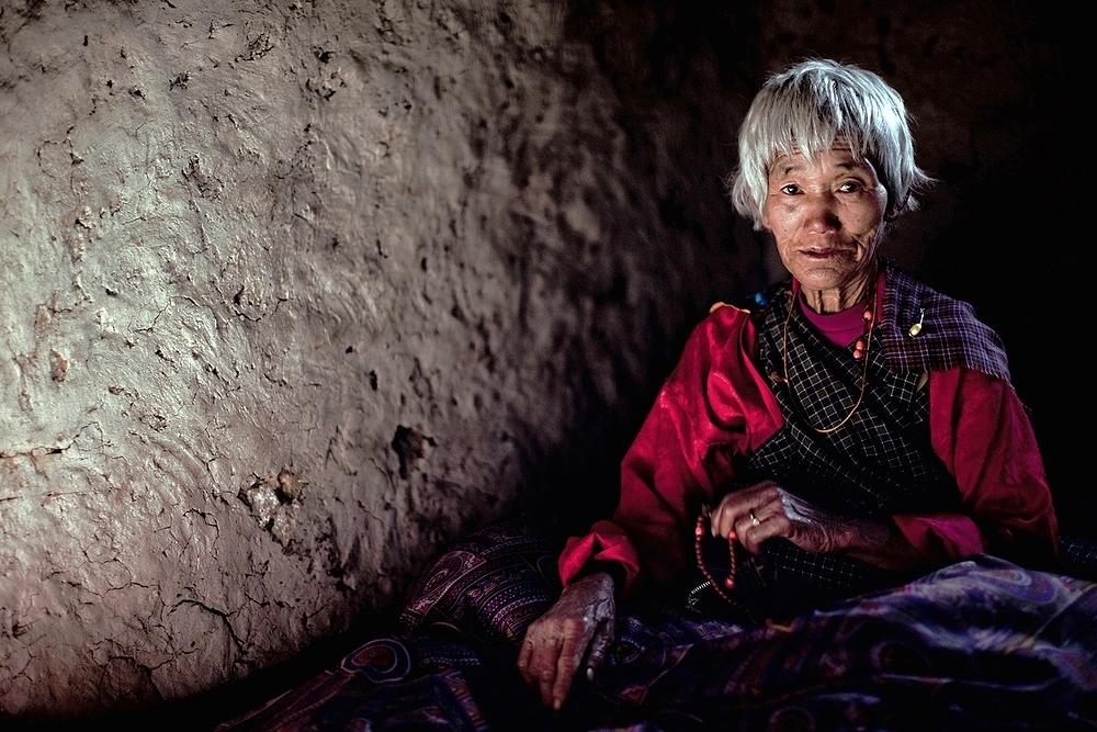 Bhutanese woman on her deathbed. Bhutan, 2009.