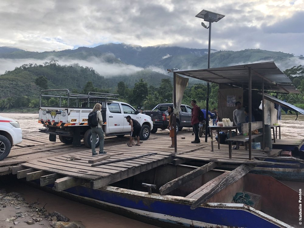 Participants boarding a ferry to cross the Perené     River and visit the native communities of Chontakiari and Palomar