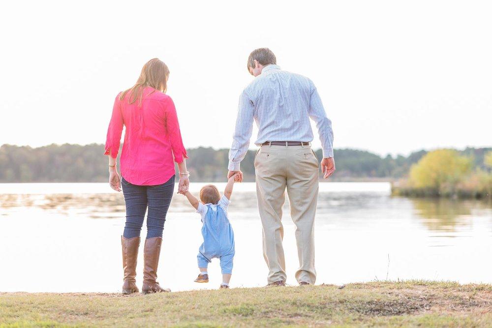 Family looking at the lake.