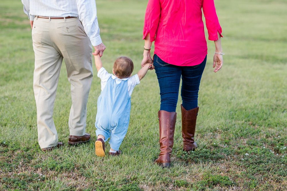 Family walking with toddler