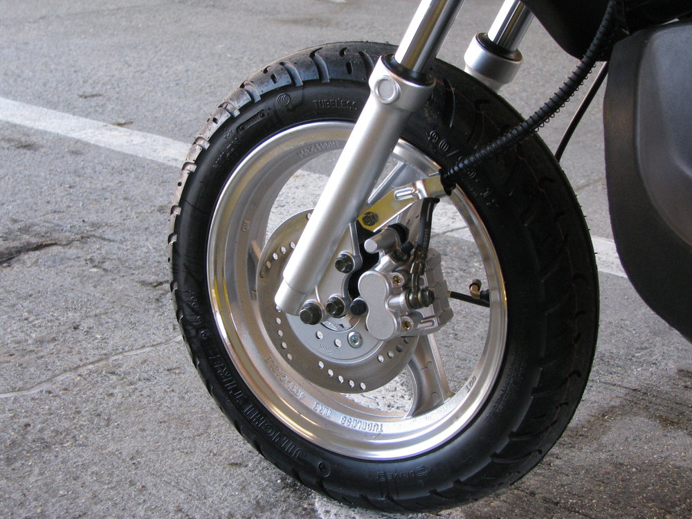 "The Ruckus clones feature a 12"" street tire with hydraulic disc brake up front - this setup will handle better than the genuine Ruckus out on the road."