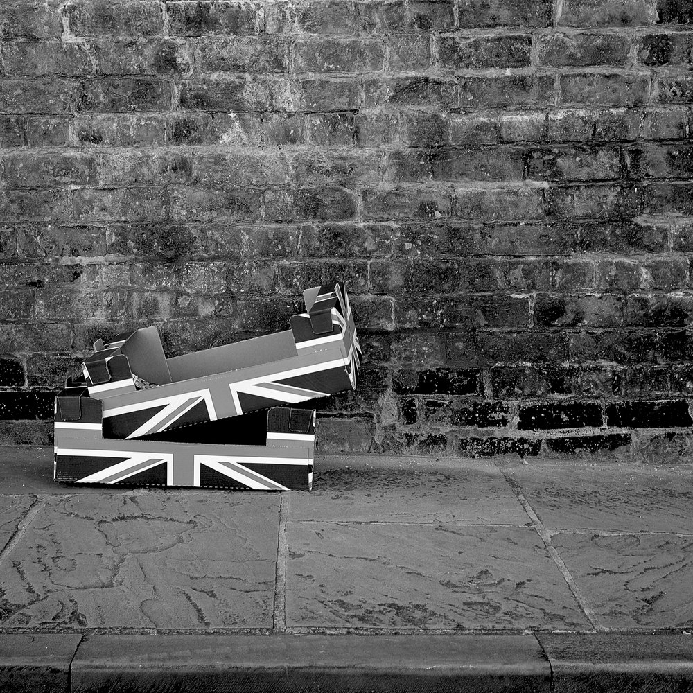 Union Jack apple boxes waiting to be picked up by the bin men.