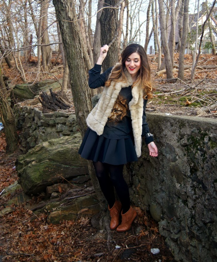 panther top, fur vest, and fringe booties - Louboutins and Love Fashion Blog