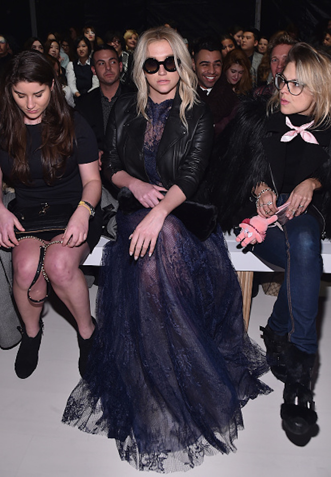 Kesha sitting front row