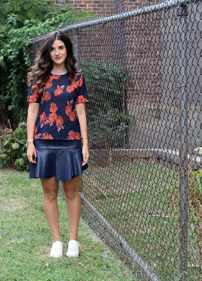 Navy Pleather Skirt White Sneakers Louboutins & Love Fashion Blog Esther Santer Street Style Blogger NYC Blue Grey Bracelet Gold Jewelry Brunette Hair Floral Top Girl Women Beauty Photoshoot Model Outdoors Outfit OOTD Lifestyle Red Zara Shop Blogger.jpg