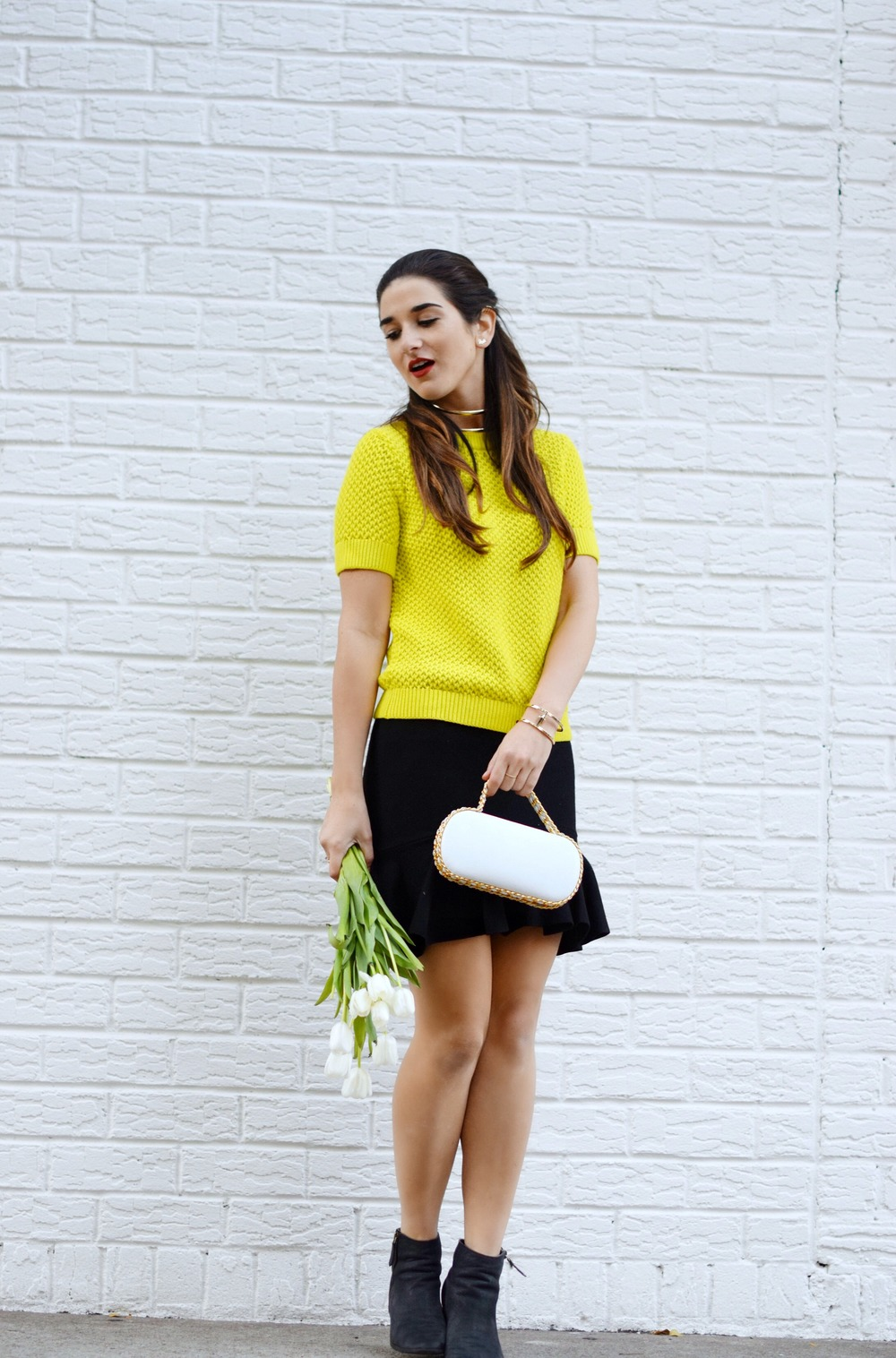White Prince Minaudiere Erin Dana Louboutins & Love Fashion Blog Esther Santer NYC Street Style Blogger Bag Giveaway Gold Jewelry Lydell Bracelet Collar Necklace Black Booties Flared Ruffle Skirt Photoshoot Model Club Monaco Neon Yellow Sweater Outfit.jpg