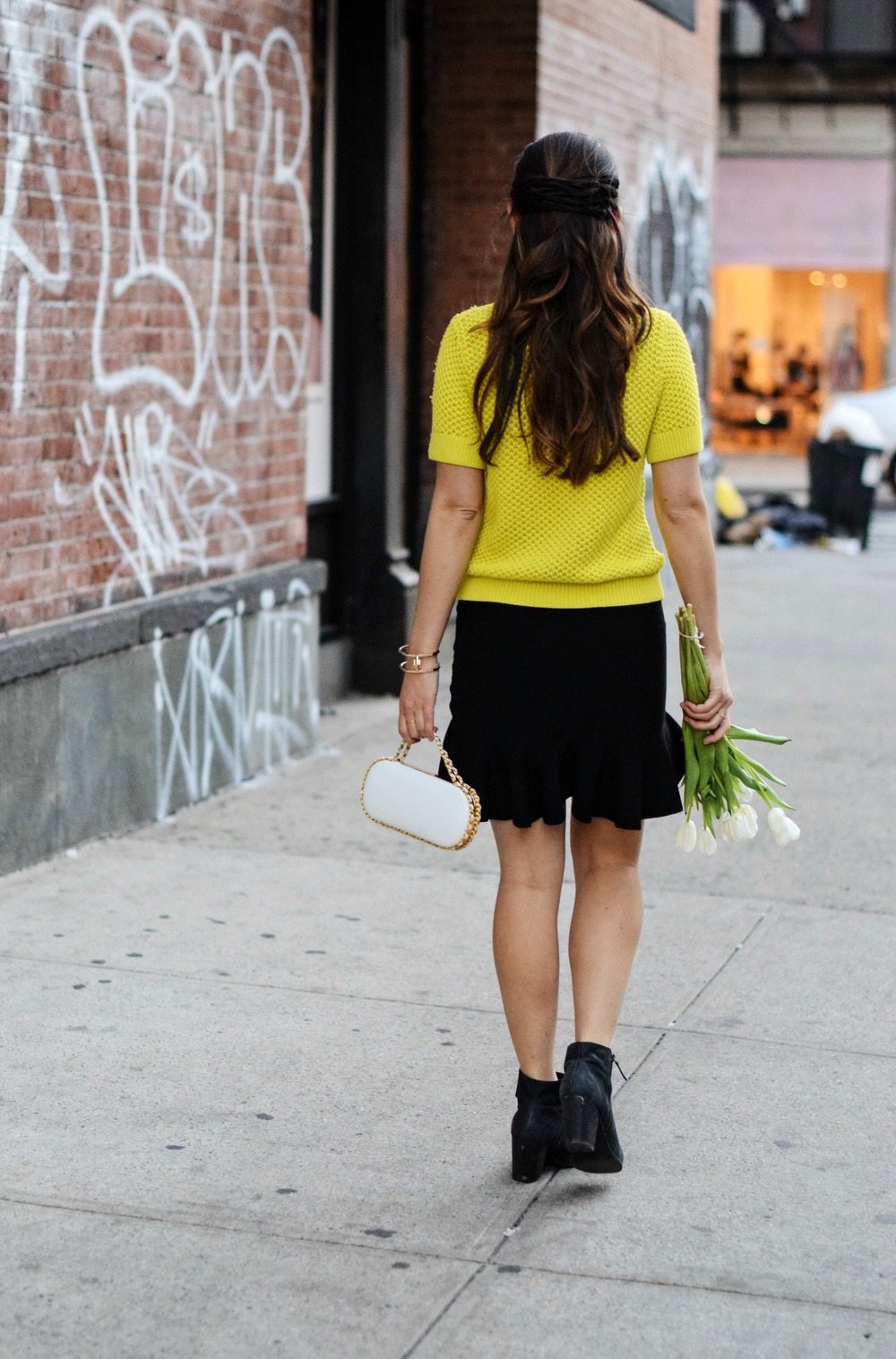 White Prince Minaudiere Erin Dana Louboutins & Love Fashion Blog Esther Santer NYC Street Style Blogger Bag Giveaway Gold Jewelry Lydell Bracelet Collar Necklace Black Booties Flared Ruffle Skirt Photoshoot Model Outfit Club Monaco Neon Yellow Sweater.jpg