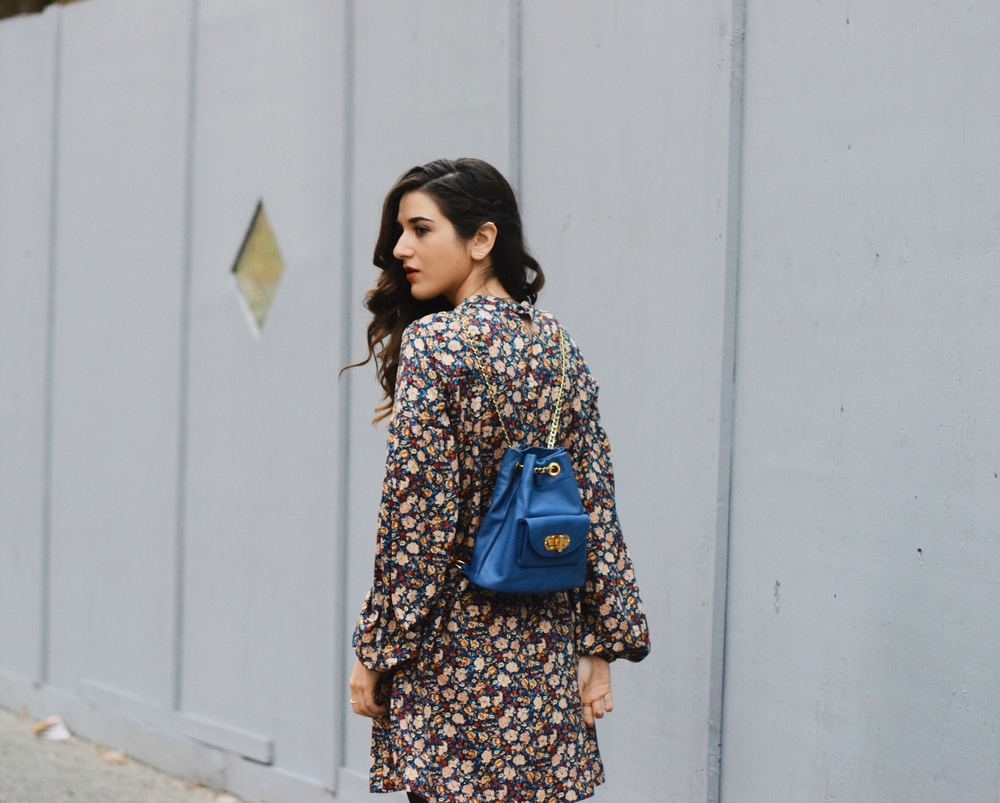 Floral Dress Blue Leather Backpack Louboutins & Love Fashion Blog Esther Santer NYC Street Style Blogger Black Tights Fringe Preta Ivanka Trump Booties Hair Girl Women Shopping Inspo Inspiration Model New York City Photoshoot Winter Trendy Outfit OOTD.jpg