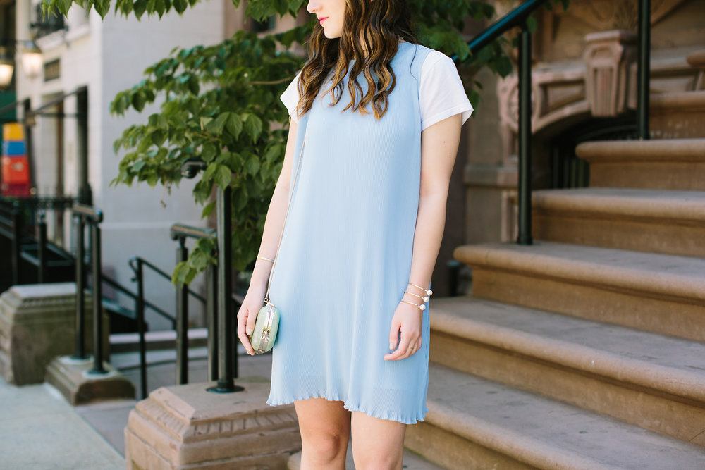 Pastel Blue Pleated Dress Keepsake The Label Louboutins & Love Fashion Blog Esther Santer NYC Street Style Blogger Outfit OOTD Pretty Photoshoot Upper East Side Dolce Vita Wedges Gold Jewelry Club Monaco Clutch White Women Tee Shirt Inspo Summer Look.jpg