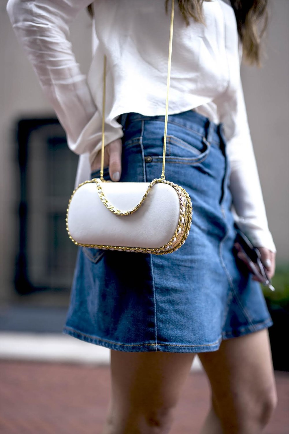 White Silk Top Chelsea and Walker Louboutins & Love Fashion Blog Esther Santer NYC Street Style Blogger Outfit OOTD Trendy Jean Denim Skirt Zara Clutch Bag Erin Dana Gold Chain Ivanka Trump Fringe Booties TeamIvanka Women Girl Transitional Pieces Fall.jpg