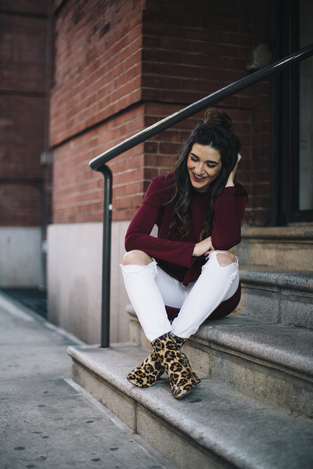 Knotted Dress + Ripped White Jeans 4 Ways To Build Connections Louboutins & Love Fashion Blog Esther Santer NYC Street Style Blogger Outfit OOTD Trendy Red Maroon Burgundy Winter Color Leopard Coach Booties Pants Girl Women Topknot Bun Hair Shoes Wear.jpg
