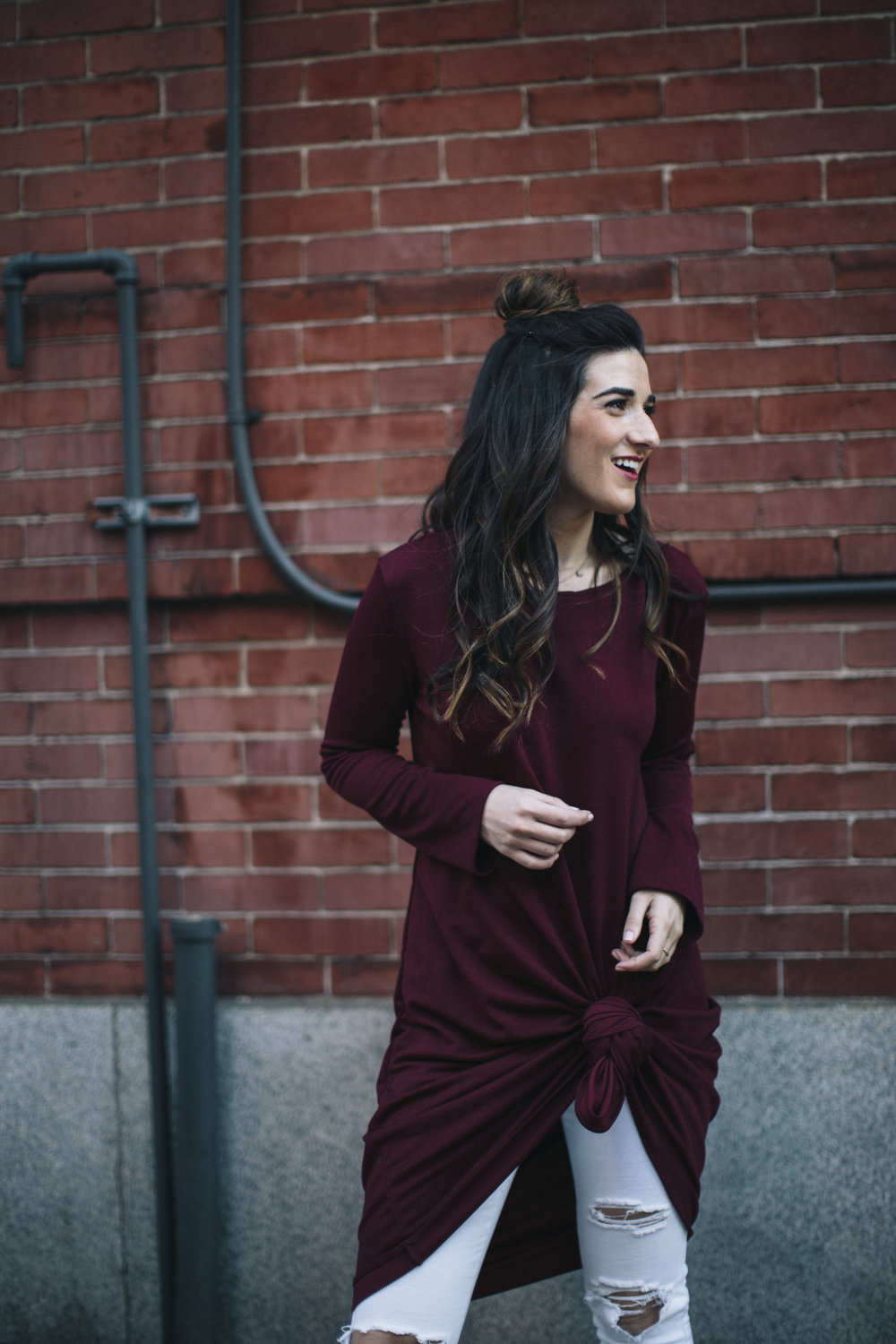 Knotted Dress + Ripped White Jeans 4 Ways To Build Connections Louboutins & Love Fashion Blog Esther Santer NYC Street Style Blogger Outfit OOTD Trendy Red Maroon Burgundy Winter Color Leopard Coach Shoes Booties Pants Girl Women Bun Topknot Hair Wear.jpg