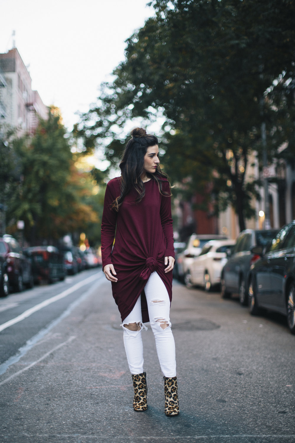 Knotted Dress + Ripped White Jeans 4 Ways To Build Connections Louboutins & Love Fashion Blog Esther Santer NYC Street Style Blogger Outfit OOTD Trendy Red Maroon Burgundy Winter Color Leopard Coach Shoes Booties Pants Girl Women Topknot Bun Hair Wear.jpg