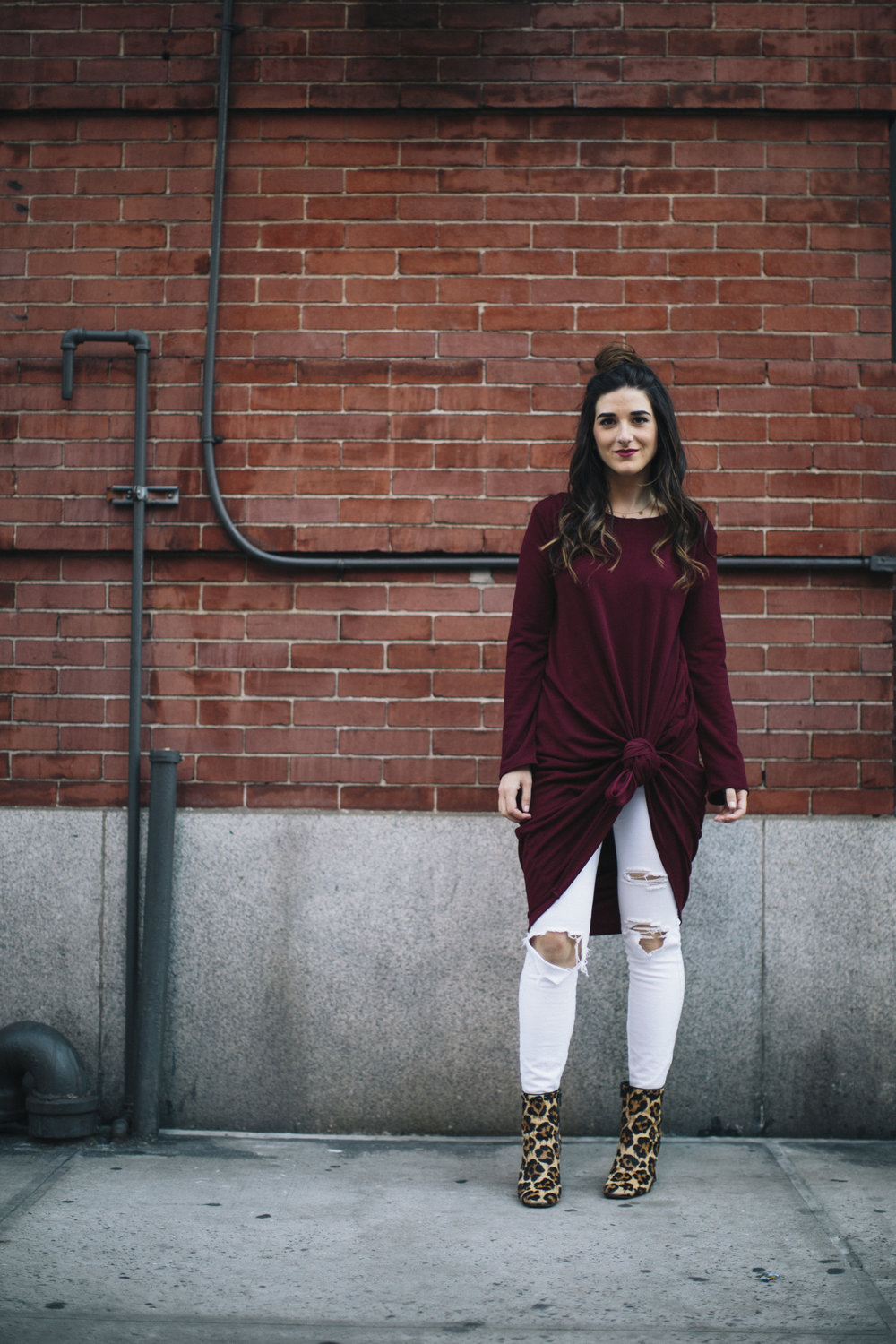 Knotted Dress + Ripped White Jeans 4 Ways To Build Connections Louboutins & Love Fashion Blog Esther Santer NYC Street Style Blogger Outfit OOTD Trendy Red Maroon Burgundy Winter Wear Color Leopard Coach Shoes Booties Pants Girl Women Topknot Bun Hair.jpg