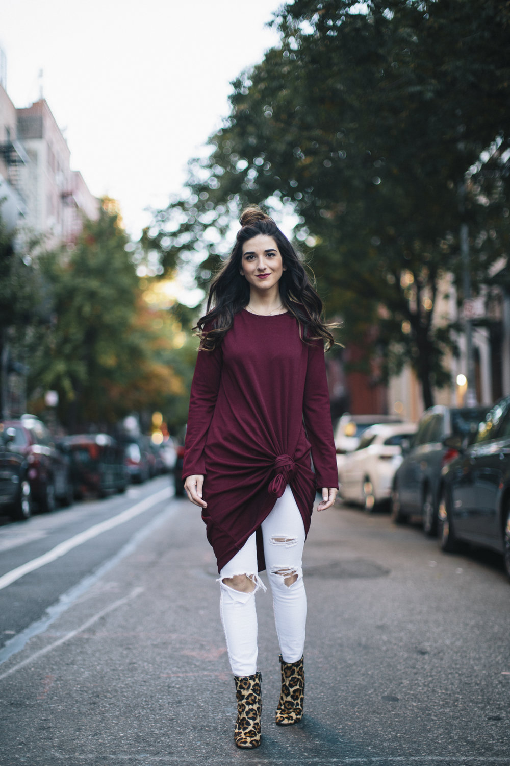 Knotted Dress + Ripped White Jeans 4 Ways To Build Connections Louboutins & Love Fashion Blog Esther Santer NYC Street Style Blogger Outfit OOTD Trendy Red Maroon Burgundy Winter Wear Color Leopard Coach Shoes Booties Pants Topknot Hair Bun Women Girl.jpg