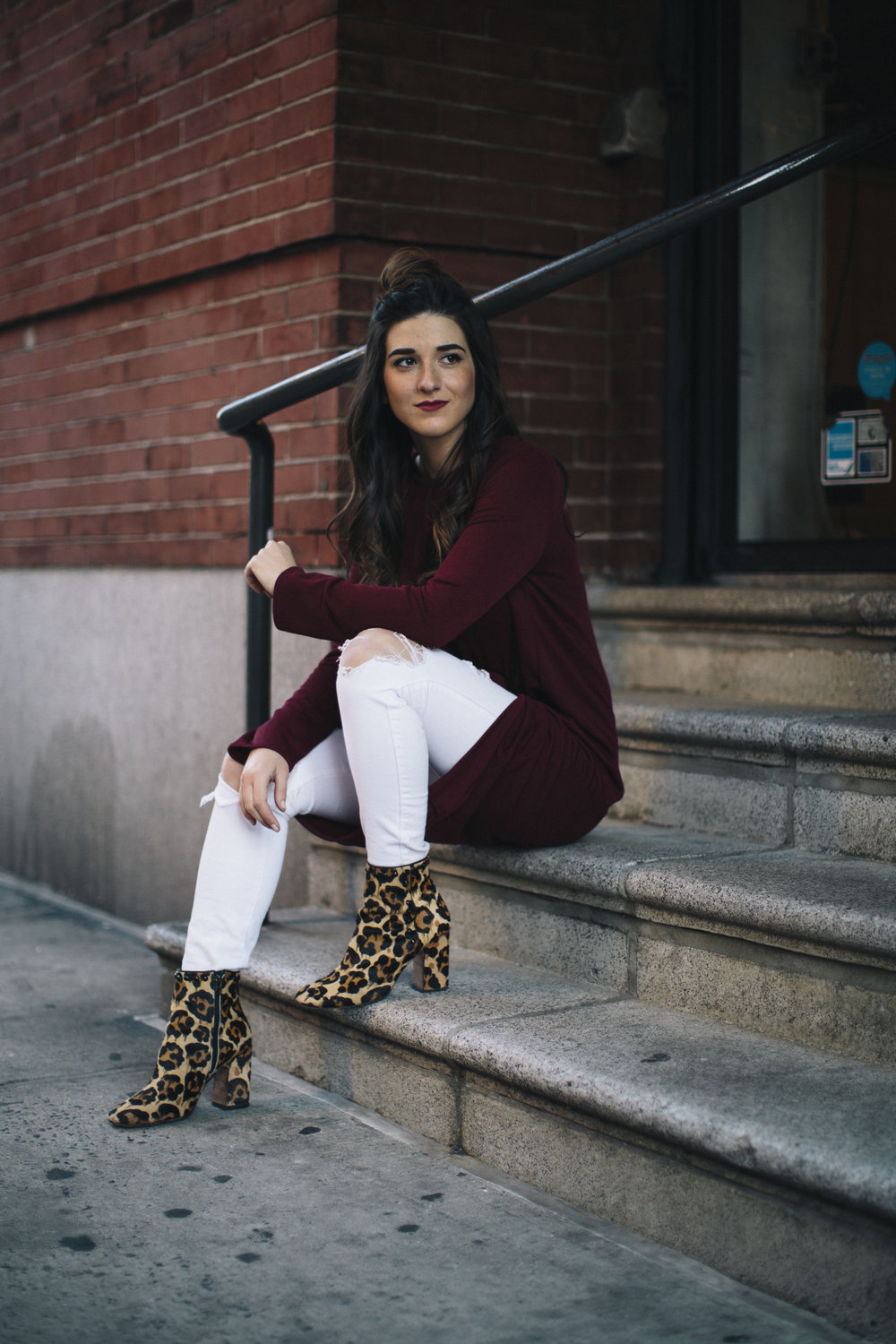 Knotted Dress + Ripped White Jeans 4 Ways To Build Connections Louboutins & Love Fashion Blog Esther Santer NYC Street Style Blogger Outfit OOTD Trendy Red Maroon Burgundy Winter Wear Color Leopard Coach Shoes Booties Pants Women Girl Topknot Bun Hair.jpg
