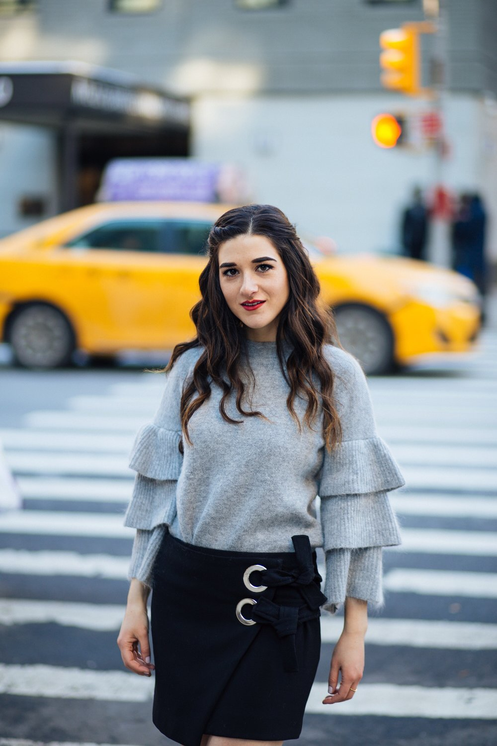Grey Ruffle Sleeve Sweater Shop Trescool Fall Winter Esther Santer Fashion Blog Louboutins & Love NYC Street Style Blogger Outfit OOTD Trendy Hair Girl Women Trendy Online Shopping Zara Wear Stylish Fashionista Beauty Photoshoot Women Black Mini Skirt.JPG