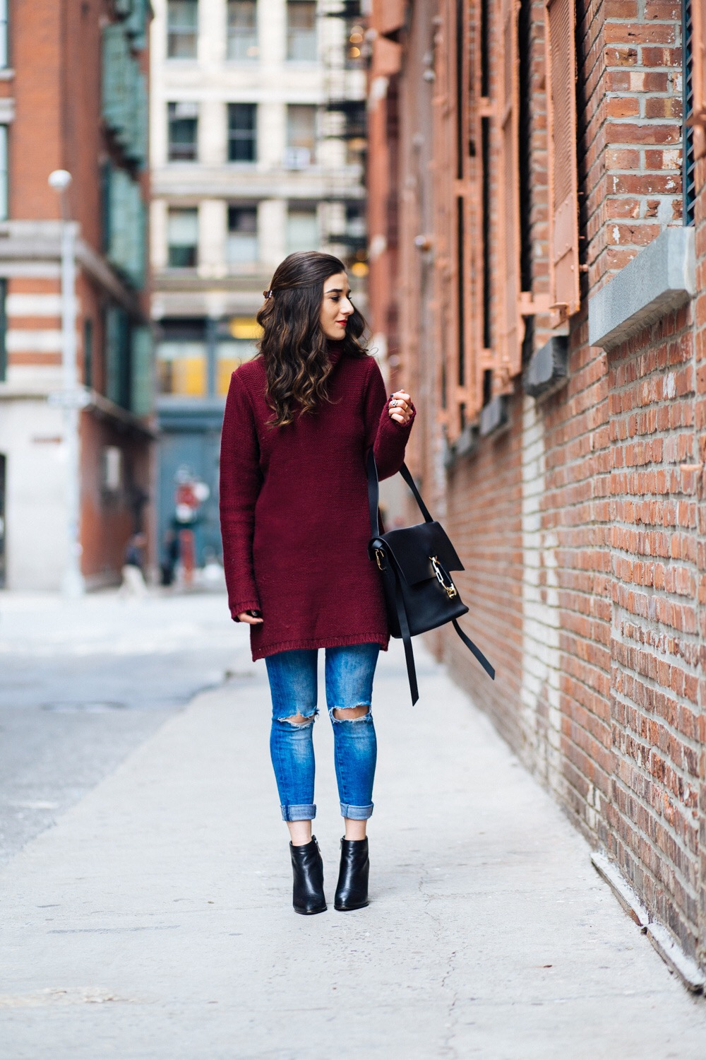 Maroon Sweater Dress Zac Posen Belay Bag 5 Tips On Balancing Work Blog And Social Life Esther Santer Fashion Blog NYC Street Style Blogger Outfit OOTD Trendy Girl Women Photoshoot Ripped Denim Jeans  Booties Hair Inspo Handbag  Purse Shoes Turtleneck.JPG