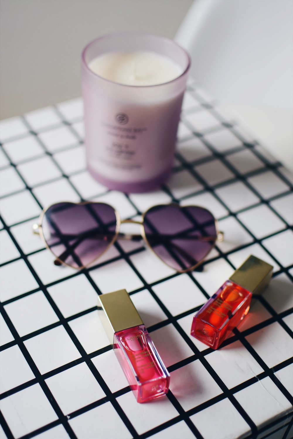 Softer Lips With Clarins Lip Oil Esther Santer Fashion Blog NYC Street Style Blogger Outfit OOTD Trendy Makeup Beauty Candle Flatlay Lipstick Color Shade Plumper Sunglasses Perfume Pretty Product Review  Shop Girl Women Orange Tangerine Pink Candy Buy.JPG