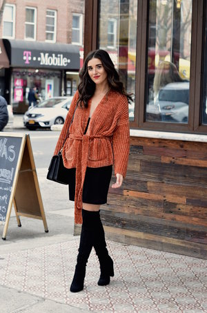 e4e7ec94aff Orange Tie Sweater + OTK Boots    10 Sweaters That Make The Perfect Holiday  Gifts