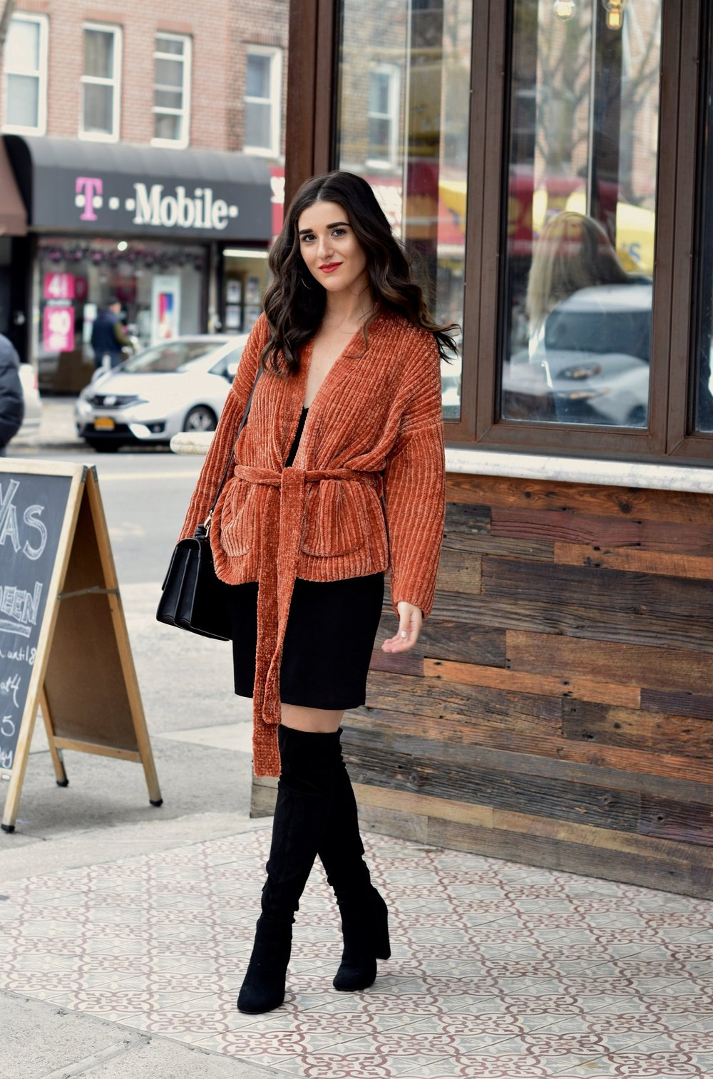 Orange Tie Sweater OTK Boots 10 Sweaters That Make The Perfect Holiday Gifts Esther Santer Fashion Blog NYC Street Style Blogger Outfit OOTD Trendy Urban Outfitters Girl Women Black Over The Knee Boots Slip Dress Beautiful New York City Cozy OOTD.jpg