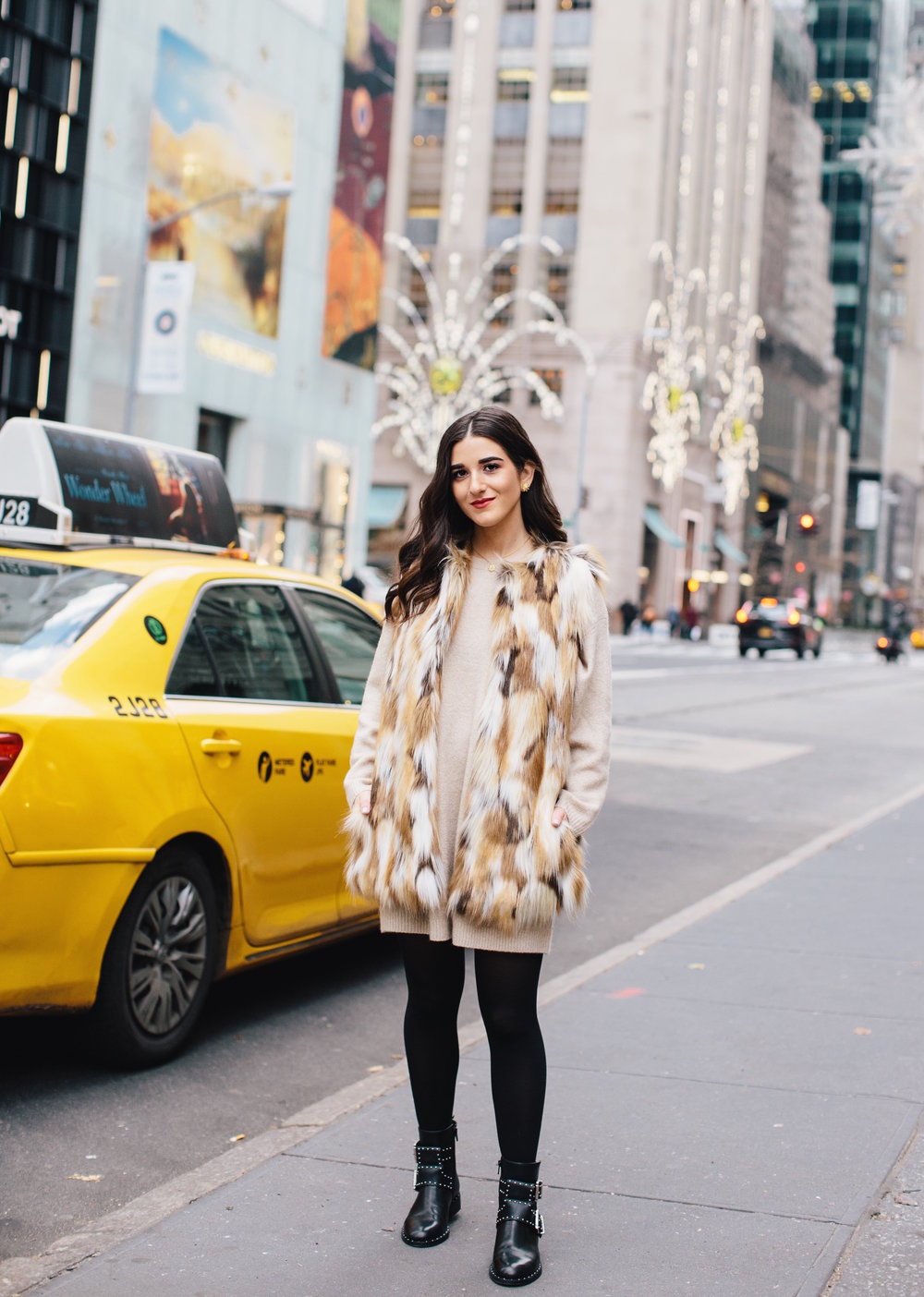 Calico Fur Vest Black Buckle Booties 5 Bad Habits To Ditch In The New Year Esther Santer Fashion Blog NYC Street Style Blogger Outfit OOTD Trendy DSW Shoes Women Girl Holiday Season Window Shopping New York City  Beige Sweater Dress Tights Winter Cozy.JPG