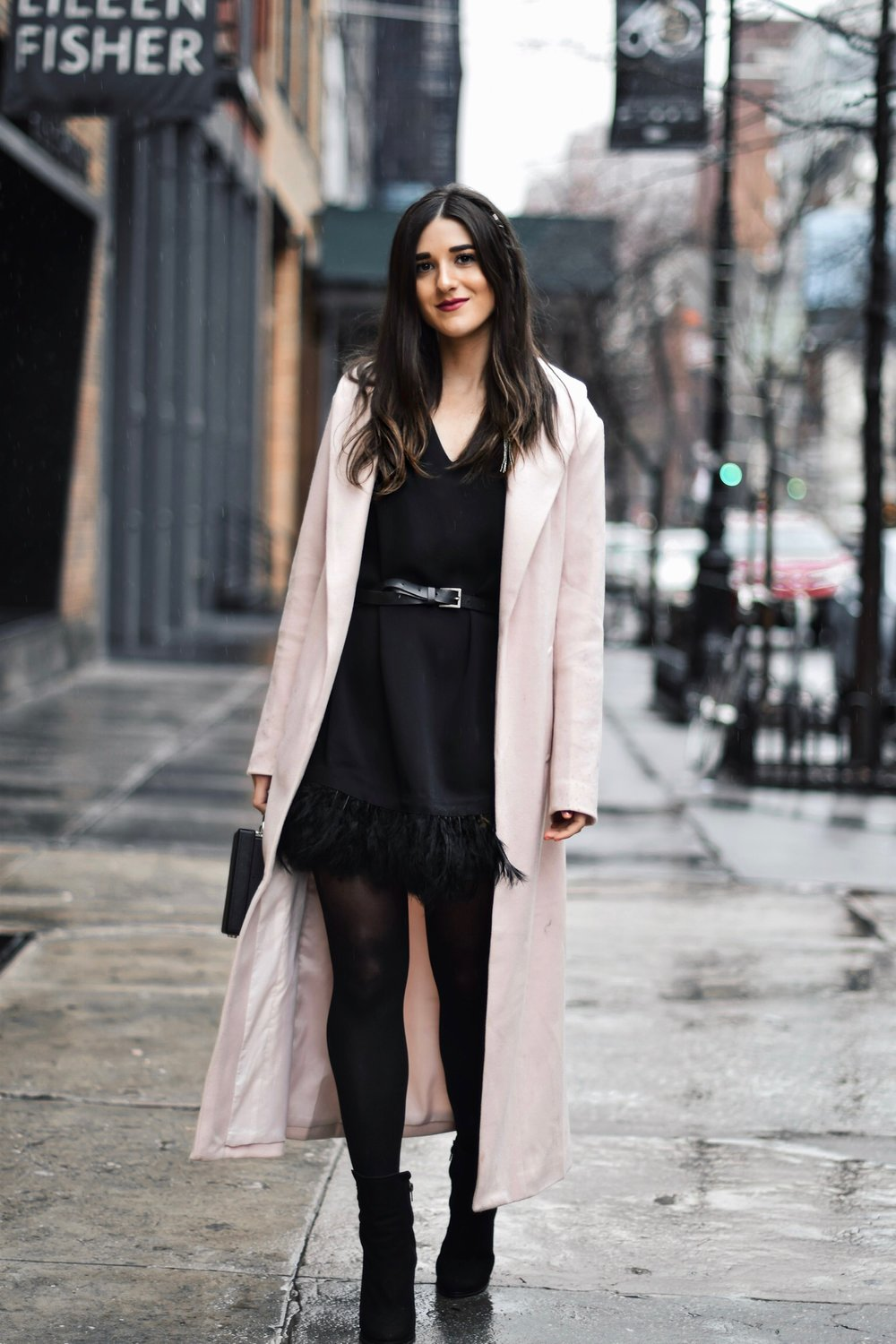 How To Stay Grounded Black Feather Trim Dress Long Pink Coat Esther Santer Fashion Blog NYC Street Style Blogger Outfit OOTD Trendy Saks Off 5th Feather Trim Dress Black Tights Booties M4D3 Shoes ASOS Belt Blush Box Clutch Bag Shop Wear Cozy Winter.jpg