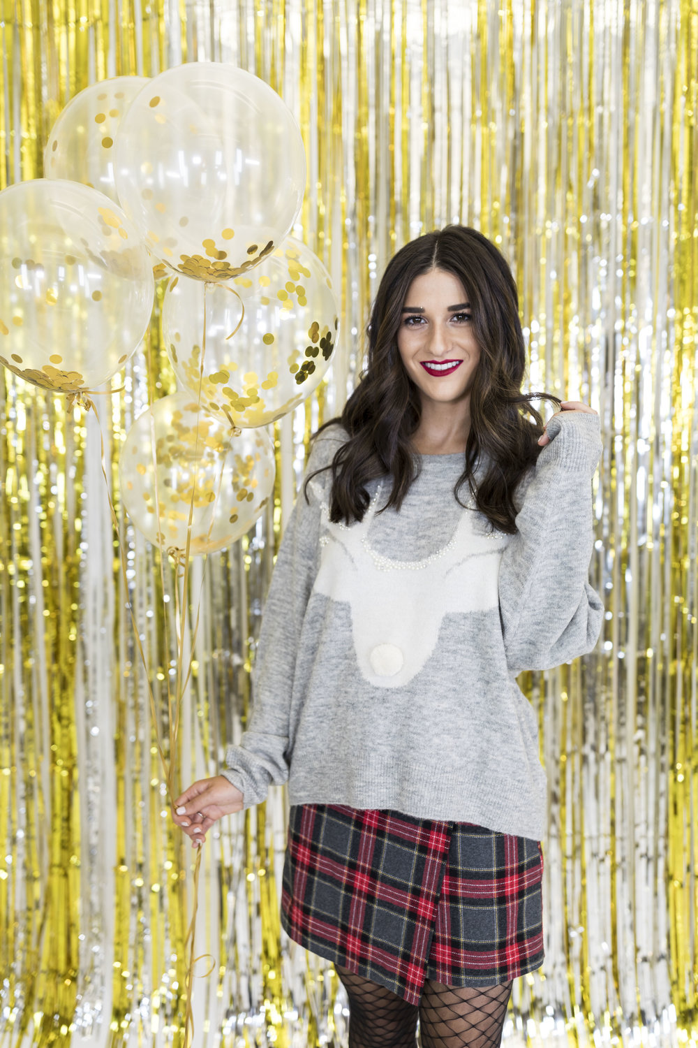 H&M Holiday Video Collab Esther Santer Fashion Blog NYC Street Style Blogger Outfit OOTD Trendy Confetti Streamers Balloons Presents Gift Wrap Shopping Wear Stylist Photoshoot Sweater Plaid Skirt DryBar Hairstyle Girl Friends Smile Jewelry Accessories.jpg