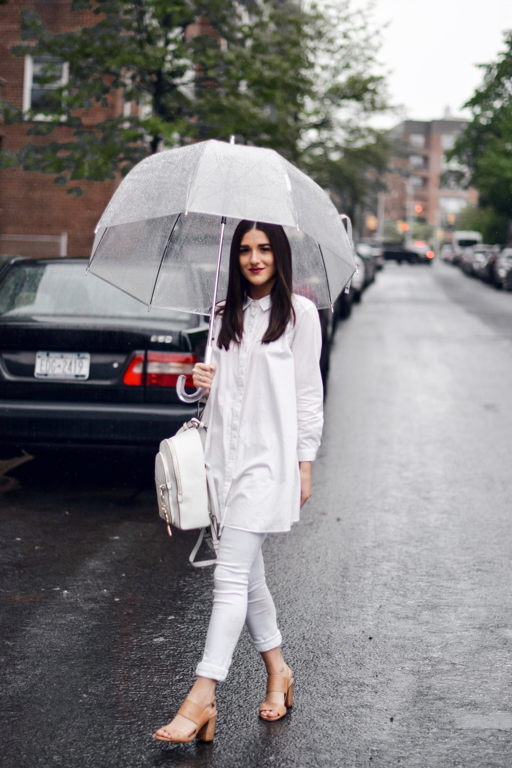 Why I Won't Be Bringing My Camera Or Laptop To Portugal Or Spain All White Look Esther Santer Fashion Blog NYC Street Style Blogger Outfit OOTD Trendy Shopping Umbrella Rainy Day Button Down Sandals Heels Zara Pants Straight Hair Girl Women New York.jpg