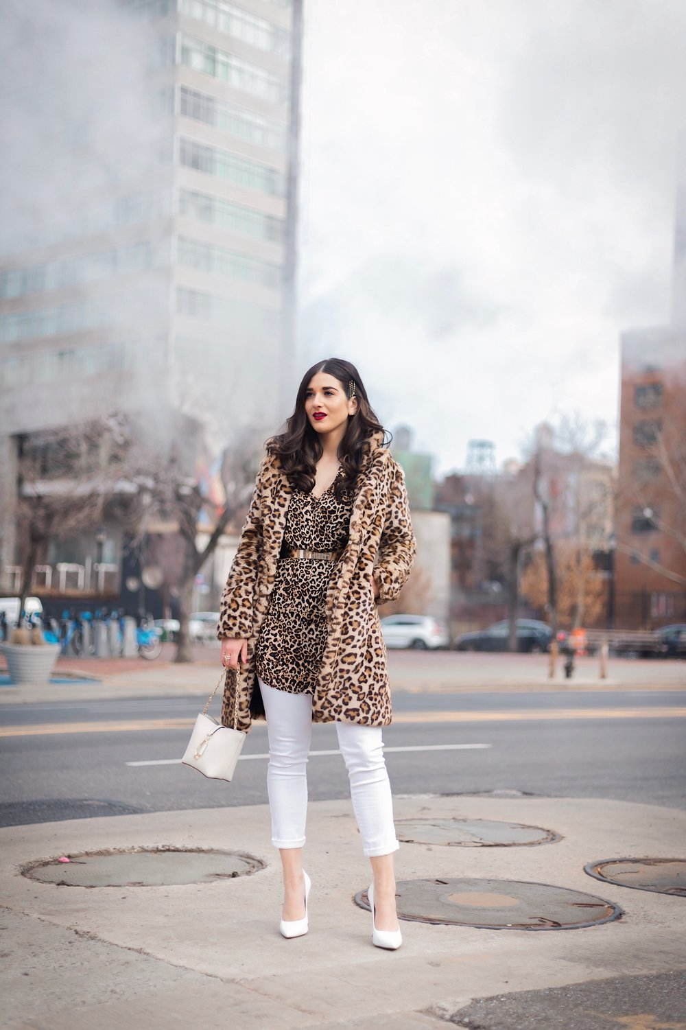 Dressing Up My Democracy Denim Esther Santer Fashion Blog NYC Street Style Blogger Outfit OOTD Trendy Shopping White Jeans Leopard Top Coat Inspo Bobby Pins Hair Trend White Heels Wear Chaya Ross Photography Cream Chain Small Bag Gold Belt Inspiration.jpg