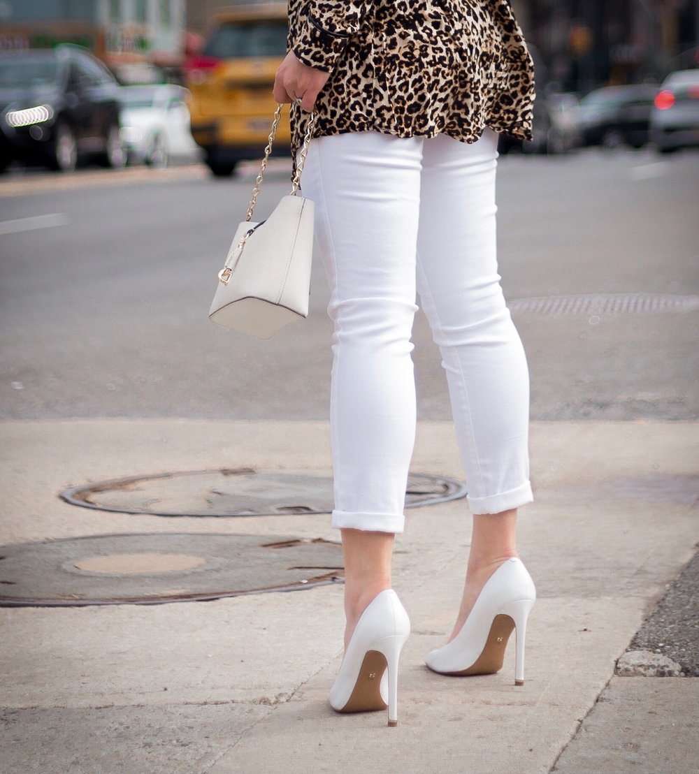 Dressing Up My Democracy Denim Esther Santer Fashion Blog NYC Street Style Blogger Outfit OOTD Trendy Shopping White Jeans Leopard Top Coat Inspo Bobby Pins Hair Trend White Heels Wear Gold Belt Chaya Ross Photography Inspiration Cream Chain Small Bag.jpg
