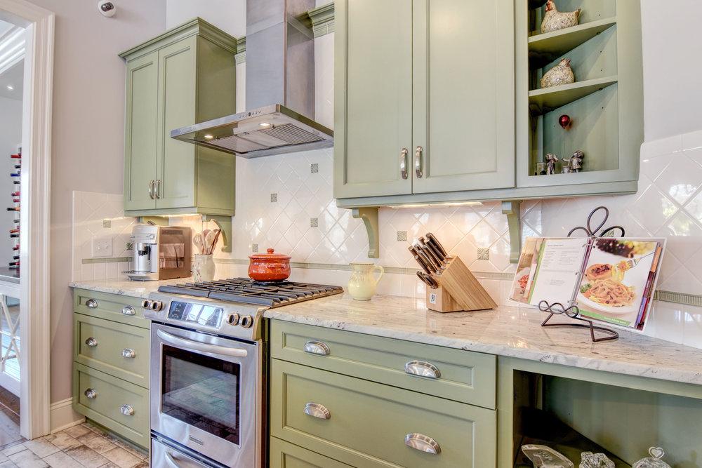 616 Woodland Forest Ct-print-018-10-Green Kitchen Cabinets Closeup-4200x2802-300dpi.jpg