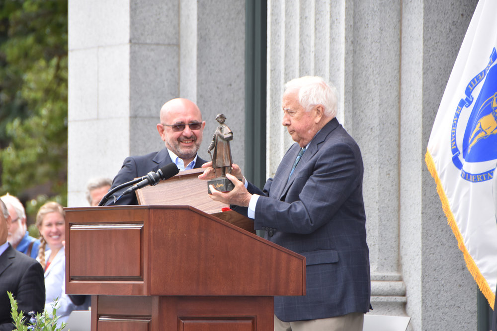 Artist Sergey Eylanbekov presents David McCullough with a replica of the John Adams statue