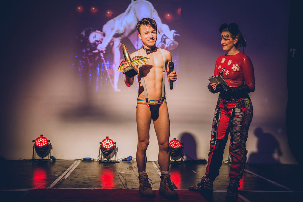 Sexual_Freedom_Awards_2016-Danny_Ash_(Performer_Winner)-Alix_Fox_(compere)-Trophy_presentation-Copyright+Credit_Gina_Jackson-(095aw).jpg