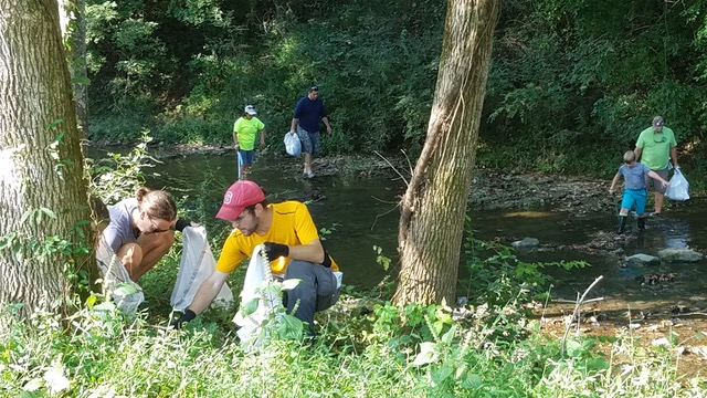El Shaddai volunteers clean Mill Creek in September 2017.