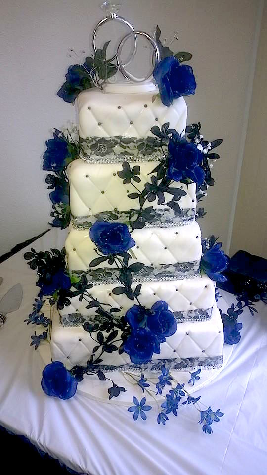 olympicbakerycustomweddingcake.jpeg