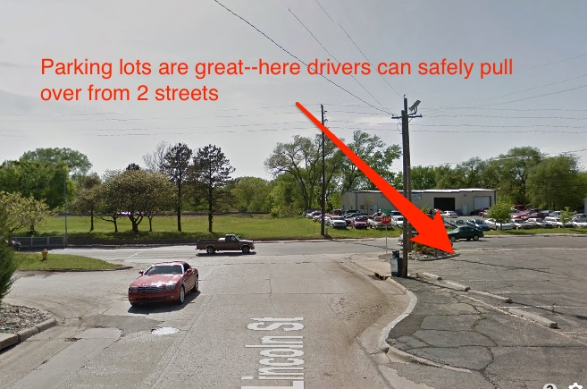 Another easy location.  Drivers can pull completely off the road.  The lot has two exits, so cars can come from either street.