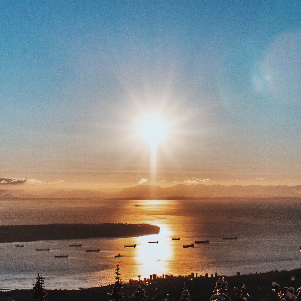 Grouse Mountain   |  The sun over English Bay
