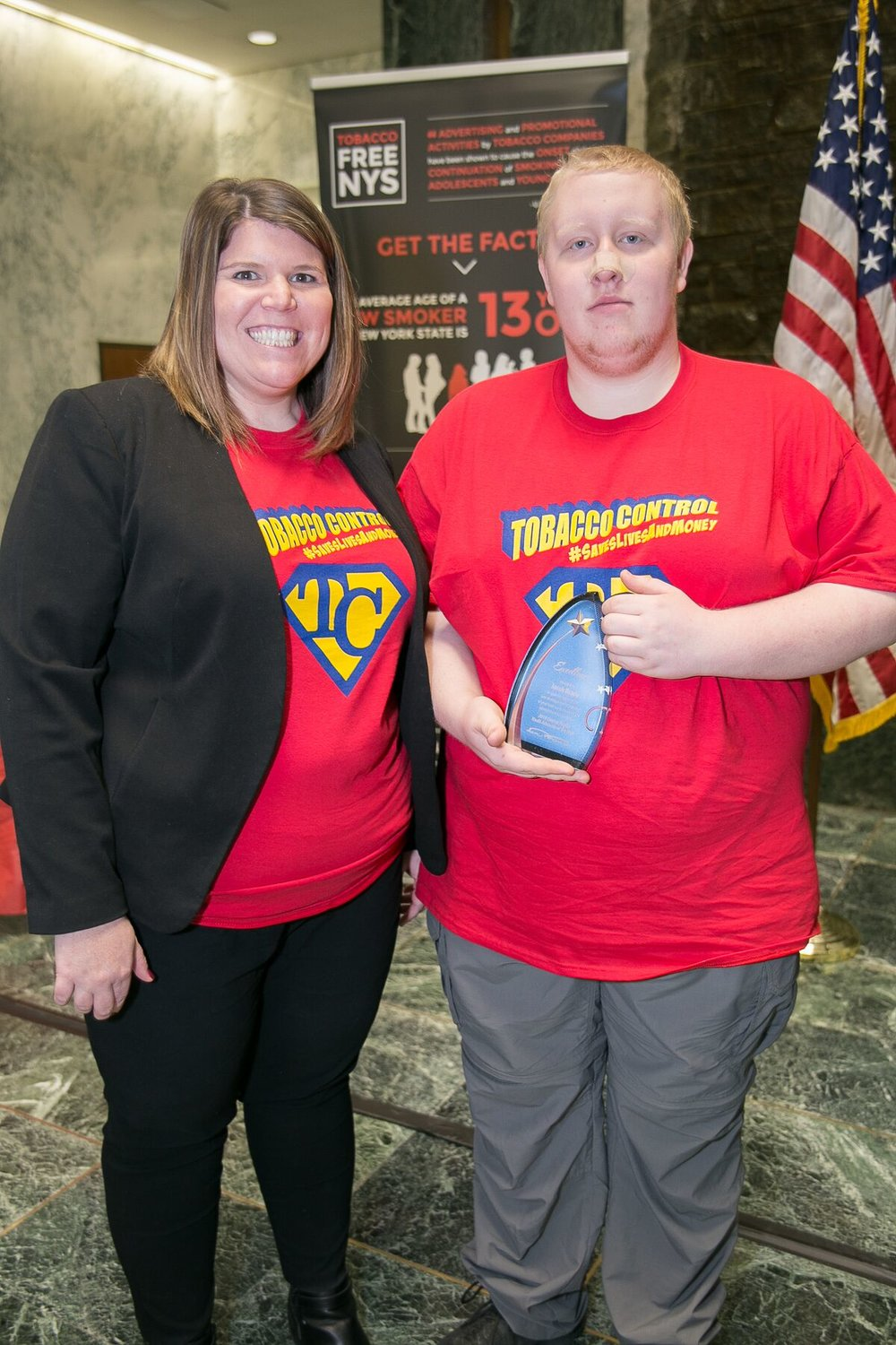 - Reality Check Program Coordinator Marissa Lamphere with the Central Region YAYA Winner Jacob Brady
