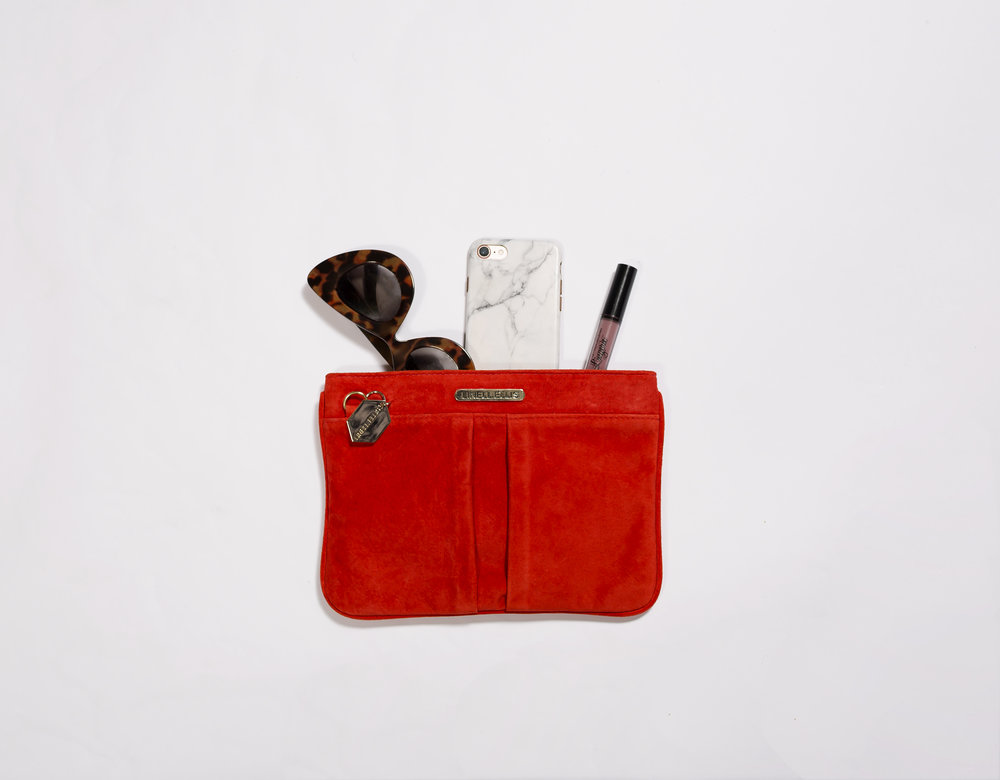 63a5a5e5f6db Our new Novella Clutch in Suede is sure to catch everyone s attention. You  can carry it easily under your arm and let the suede keep you warm.